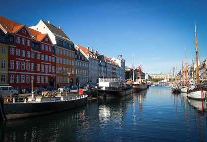copenhagen colored buildings on its river on a blue sky background